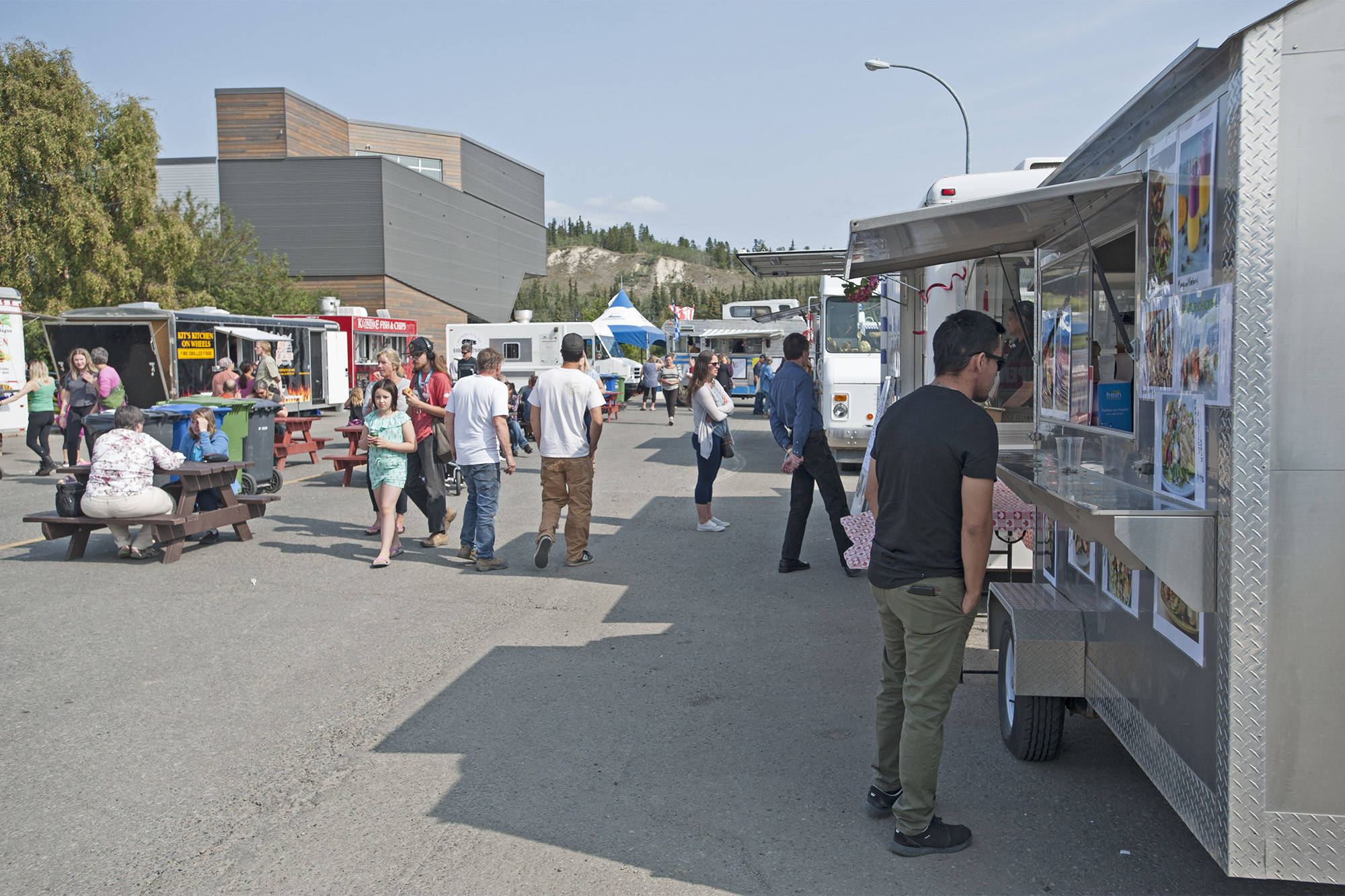 Food trucks gather on Steele Street between Front and Second for the annual Street Eats Festival in August 2019. A new partnership between the Yukon Arts Centre and City of Whitehorse will bring the community the Street Eats & Beats Cultural Festival in September. (Julien Gignac/Yukon News file)